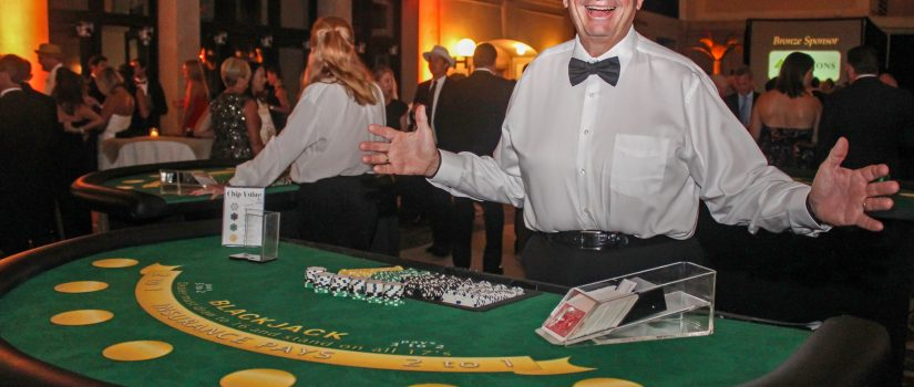 Man working a blackjack station for a casino themed party
